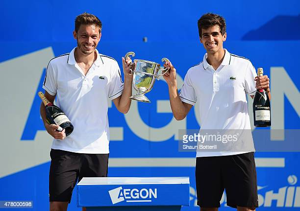 Nicolas Mahut and PierreHugues Herbert of France celebrate with the winners trophy after their victory against Marcin Matkowski of Poland and Nenad...