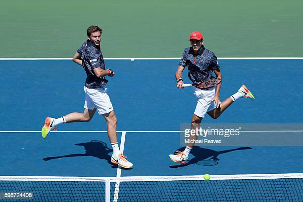 Nicolas Mahut and PierreHugues Herbert of France in action against Robin Haase of Netherlands and Artem Sitak of New Zealand on Day Five of the 2016...