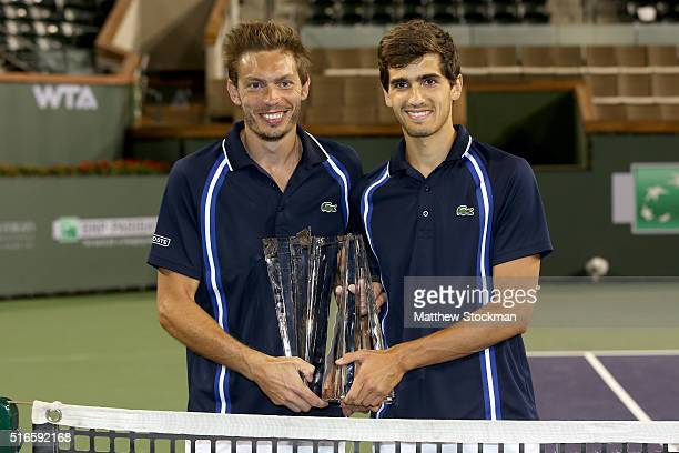 Nicolas Mahut and PierreHugues Herbert of France pose with the winner's trophy after defeating Vasek Pospisil and Jack Sock during the doubles final...