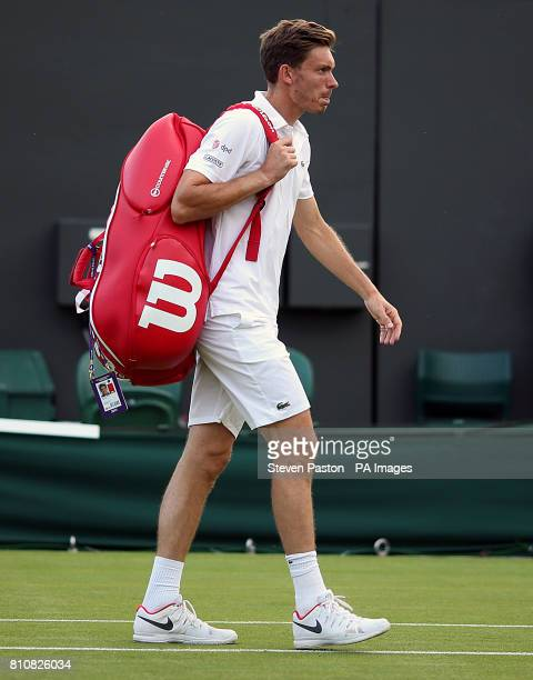 Nicolas Mahut is dejected following defeat to Marcus Willis and Jay Clarke on day six of the Wimbledon Championships at The All England Lawn Tennis...