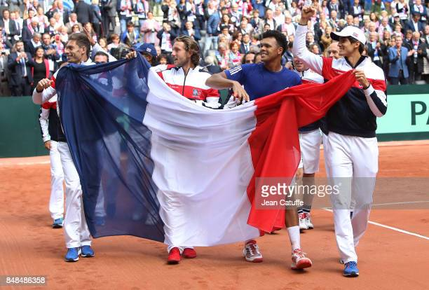 Nicolas Mahut Lucas Pouille JoWilfried Tsonga PierreHugues Herbert of France celebrate winning the tie on day three of the Davis Cup World Group tie...