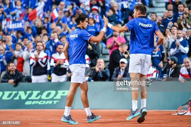 Nicolas Mahut of France and Pierre Hugues Herbert shakes hand during the day 2 of the Semifinals of the Davis Cup between France and Serbia at Stade...
