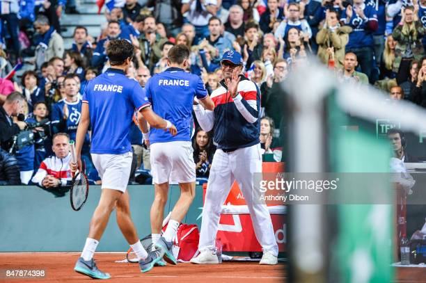 Nicolas Mahut of France and Pierre Hugues Herbert shakes hand with Yannick Noah coach of France during the day 2 of the Semifinals of the Davis Cup...
