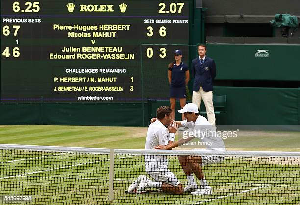Nicolas Mahut of France and PierreHugues Herbert of France celebrate victory following the Men's Doubles Final against Julien Benneteau of France and...