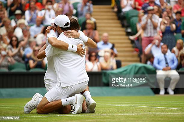 Nicolas Mahut of France and PierreHugues Herbert of France celebrates victory following the Men's Doubles Final against Julien Benneteau of France...