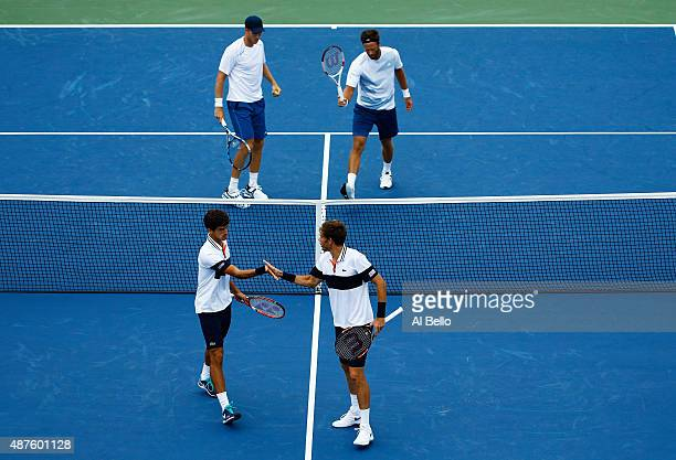 Nicolas Mahut of France and PierreHugues Herbert of France react against Dominic Inglot of Great Britain and Robert Lindstedt of Sweden during their...