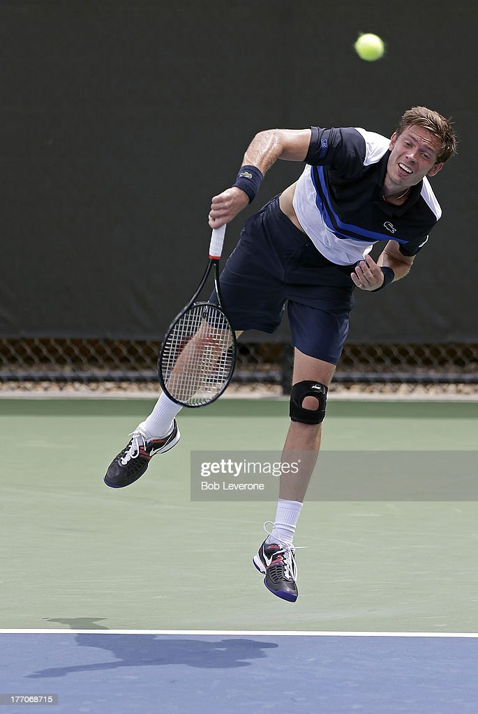Nicolas Mahut of France goes airborne as he follows through on a serve to Argentina's Juan Monaco on August 20, 2013 in Winston Salem, North Carolina.