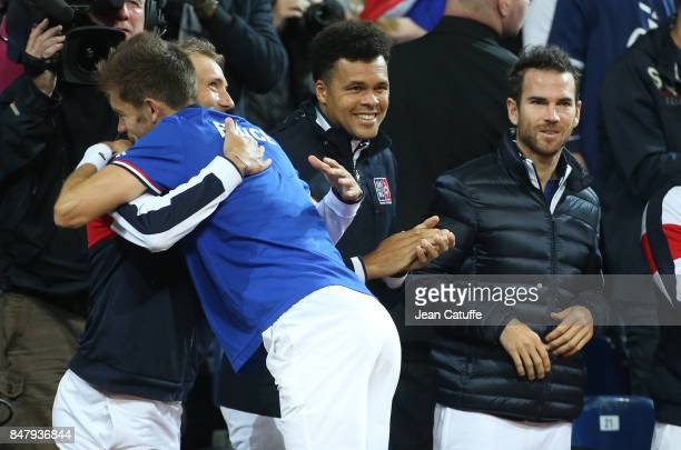 Nicolas Mahut of France greets teammates Lucas Pouille JoWilfried Tsonga Adrian Mannarino after winning the doubles match against Serbia on day two...