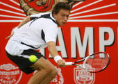 Nicolas Mahut of France plays a backhand stroke during the first round singles match against Igor Kunitsyn of Russia during Day 1 of the Artois...