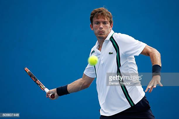 Nicolas Mahut of France plays a forehand in his first round match against Marco Cecchinato of Italy during day two of the 2016 Australian Open at...