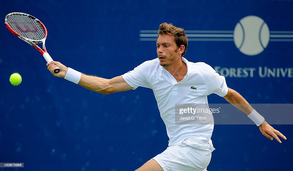 Nicolas Mahut of France returns a shot from Andreas Seppi of Italy during the Winston-Salem Open at Wake Forest University on August 20, 2014 in Winston Salem, North Carolina.