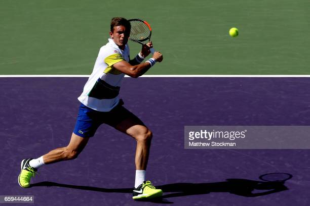 Nicolas Mahut of France returns a shot to Rafael Nadal of Spain during the Miami Open at the Crandon Park Tennis Center on March 28 2017 in Key...