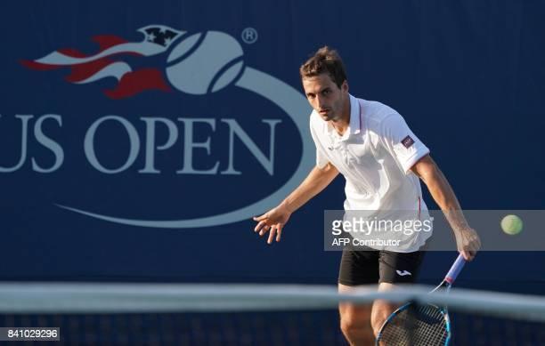 Nicolas Mahut of France returns against Albert RamosVinolas of Spain during their 2017 US Open Tennis Tournament match on August 30 2017 in New York...