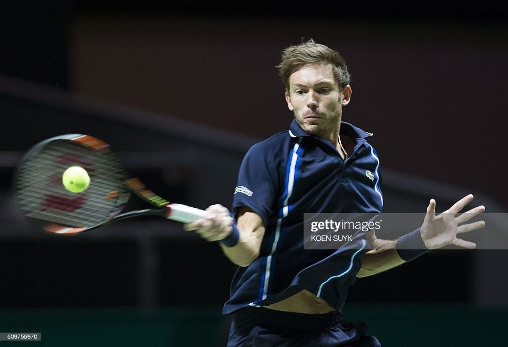 Nicolas Mahut of France returns the ball to Viktor Troicki of Serbia in the quarterfinals of the ABN AMRO World Tennis Tournament in Rotterdam, on February 12, 2016. / AFP / ANP / Koen Suyk / Netherlands OUT