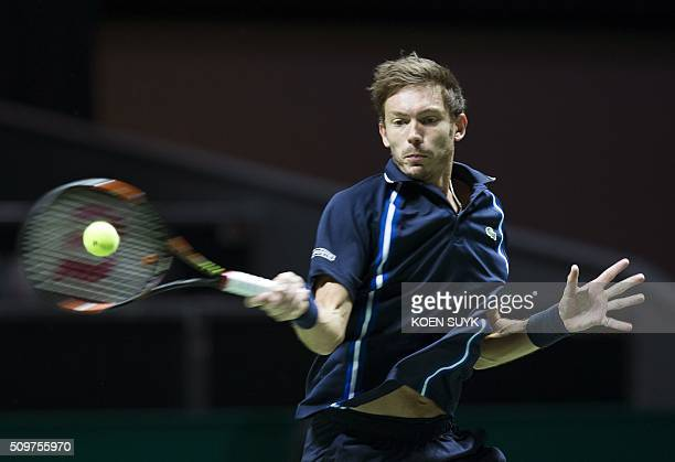 Nicolas Mahut of France returns the ball to Viktor Troicki of Serbia in the quarterfinals of the ABN AMRO World Tennis Tournament in Rotterdam on...