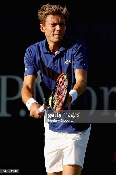 Nicolas Mahut of France serves against Albert RamosVinolas of Spain during their second round Men's Singles match on Day Three of the 2017 US Open at...
