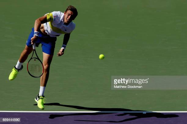 Nicolas Mahut of France serves to Rafael Nadal of Spain during the Miami Open at the Crandon Park Tennis Center on March 28 2017 in Key Biscayne...
