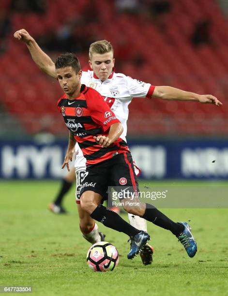 Nicolas Martinez of the Wanderers competes for the ball against Riley McGree of Adelaide United during the round 22 ALeague match between the Western...