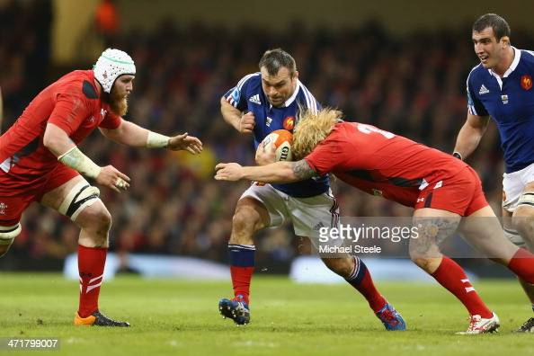 Nicolas Mas of France is held up by Richard Hibbard and Jake Bell of Wales during the RBS Six Nations match between Wales and France at the...