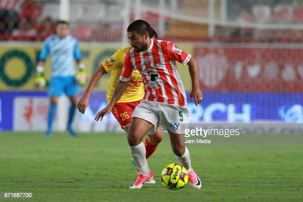 Nicolas Maturana of Necaxa drives the ball during the 15th round match between Necaxa and Morelia as part of the Torneo Clausura 2017 Liga MX at...