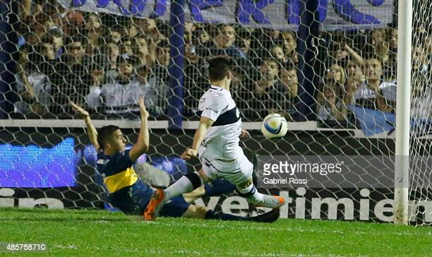 Nicola‡s Mazzola of Gimnasia y Esgrima kicks the ball to score the first goal of his team during a match between Gimnasia y Esgrima La Plata and Boca...