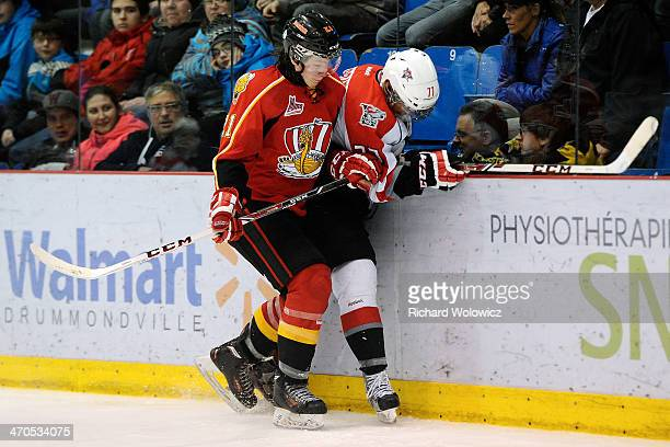 Nicolas Meloche of the Baie Comeau Drakkar body checks Jerome Verrier of the Drummondville Voltigeurs during the QMJHL game at the Centre Marcel...