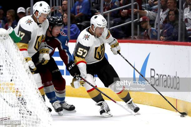 Nicolas Meloche of the Colorado Avalanche fights for control of the puck against Nick Suzuki and David Perron of the Vegas Golden Knighhts at the...