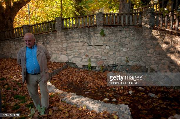 Nicolas Munoz stands next to a dried up water source in droughtstricken Albanchez de Magina near Jaen on November 20 2017 Spain and Portugal are...