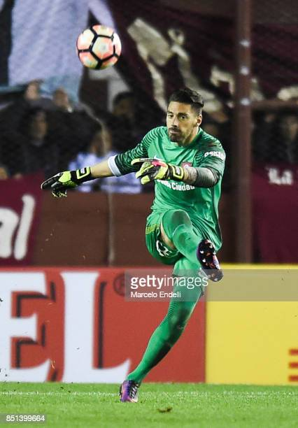 Nicolas Navarro of San Lorenzo kicks the ball during the second leg match between Lanus and San Lorenzo as part of the quarter finals of Copa...