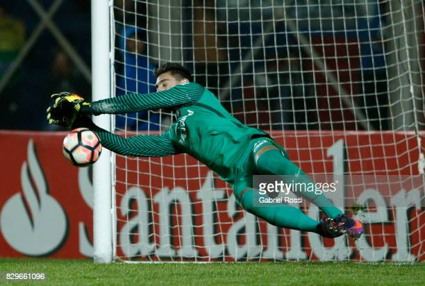 Nicolas Navarro of San Lorenzo makes a save during the penalty shootout after a second leg match between San Lorenzo and Emelec as part of round of...