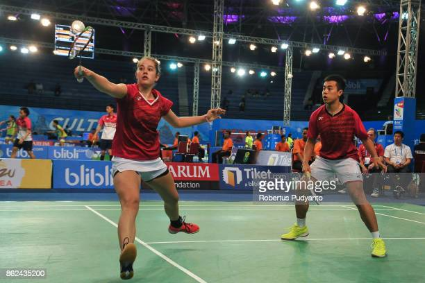 Nicolas Nguyen and Alexandra Mocanu of Canada compete against Victor Kokhanov and Elena Filippova of Russia during Mixed Double qualification round...