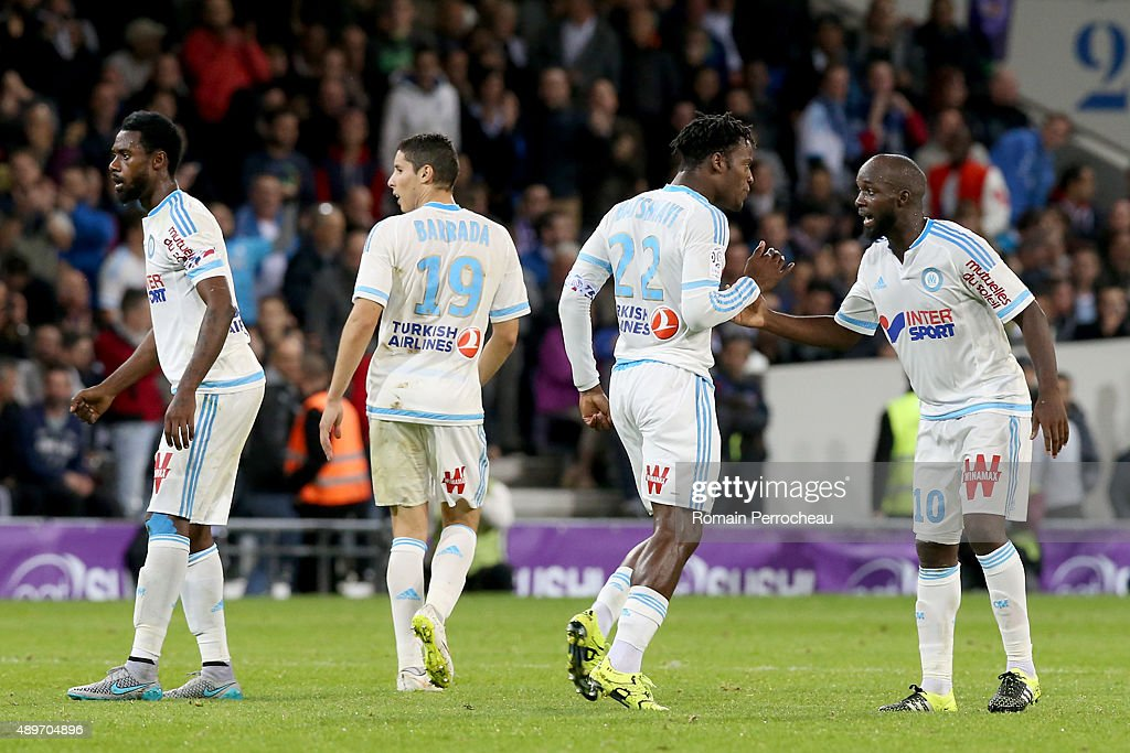 <a gi-track='captionPersonalityLinkClicked' href=/galleries/search?phrase=Nicolas+Nkoulou&family=editorial&specificpeople=5398235 ng-click='$event.stopPropagation()'>Nicolas Nkoulou</a> Abdelaziz Barrada <a gi-track='captionPersonalityLinkClicked' href=/galleries/search?phrase=Michy+Batshuayi&family=editorial&specificpeople=8599446 ng-click='$event.stopPropagation()'>Michy Batshuayi</a> (22) and <a gi-track='captionPersonalityLinkClicked' href=/galleries/search?phrase=Lassana+Diarra&family=editorial&specificpeople=607251 ng-click='$event.stopPropagation()'>Lassana Diarra</a> for Olympique de Marseille reacts after goal Of <a gi-track='captionPersonalityLinkClicked' href=/galleries/search?phrase=Michy+Batshuayi&family=editorial&specificpeople=8599446 ng-click='$event.stopPropagation()'>Michy Batshuayi</a> during the French Ligue 1 game between Toulouse FC and Olympique de Marseille at Stadium Municipal on September 23, 2015 in Toulouse, France.