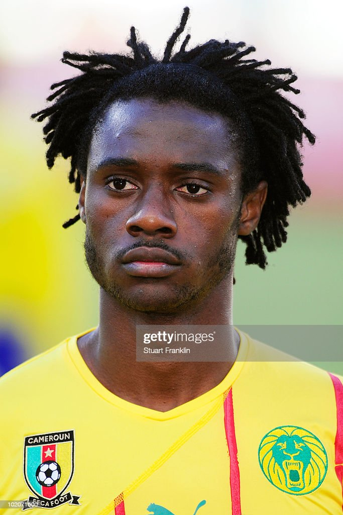 <a gi-track='captionPersonalityLinkClicked' href=/galleries/search?phrase=Nicolas+Nkoulou&family=editorial&specificpeople=5398235 ng-click='$event.stopPropagation()'>Nicolas Nkoulou</a> of Cameroon lines up for the national anthems prior to the 2010 FIFA World Cup South Africa Group E match between Japan and Cameroon at the Free State Stadium on June 14, 2010 in Mangaung/Bloemfontein, South Africa.