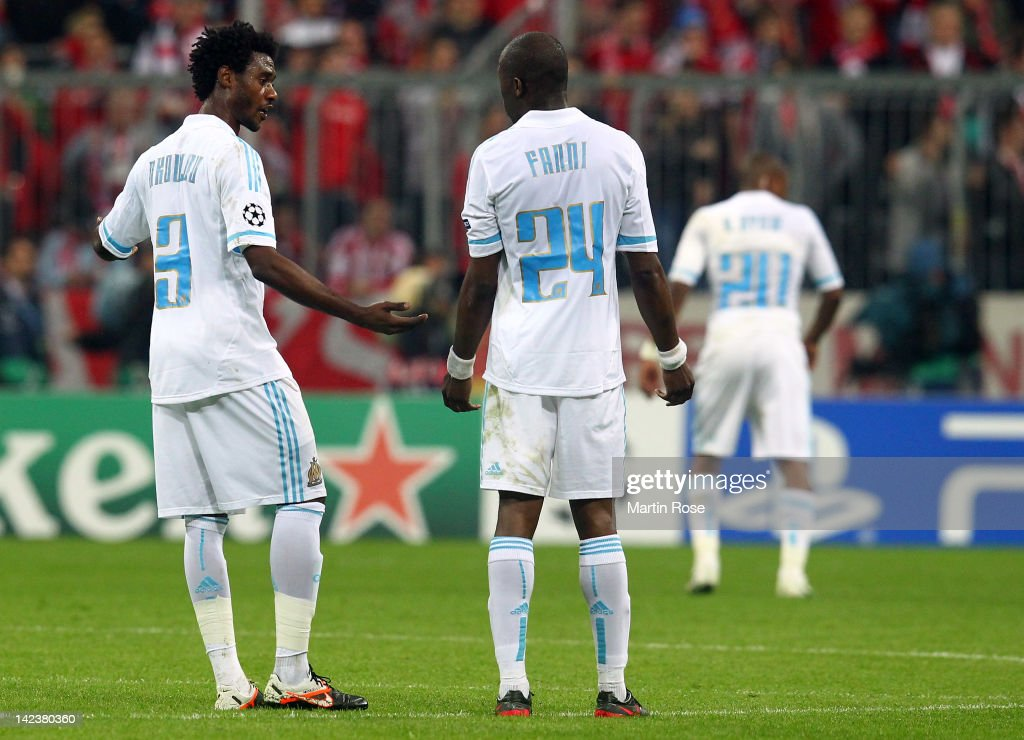 Nicolas N'Koulou of Marseille argues with teammate Rod Fanni during the UEFA Champions League quarterfinal second leg match at Allianz Arena on April...