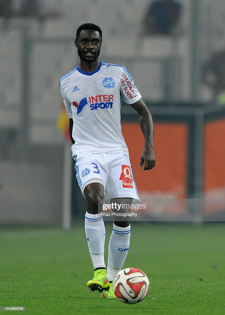 <a gi-track='captionPersonalityLinkClicked' href=/galleries/search?phrase=Nicolas+Nkoulou&family=editorial&specificpeople=5398235 ng-click='$event.stopPropagation()'>Nicolas Nkoulou</a> of Marseille in action during the French Ligue 1 match between Olympique de Marseille and OGC Nice at Stade Velodrome on August 29, 2014 in Marseille, France.