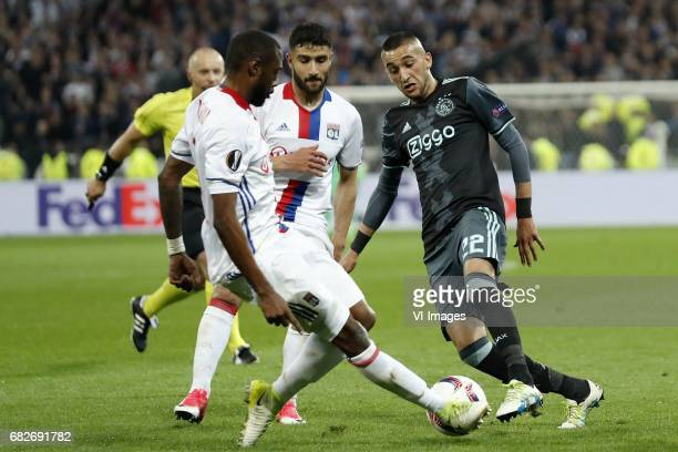 Nicolas Nkoulou of Olympique Lyonnais Nabil Fekir of Olympique Lyonnais Hakim Ziyech of Ajaxduring the UEFA Europa League semi final match between...