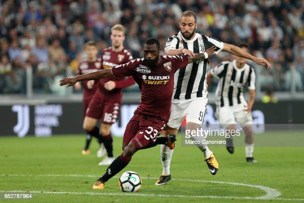 Nicolas N'Koulou of Torino FC and Gonzalo Higuian of Juventus Fc battle for the ball during the Serie A football match between Juventus Fc and Torino...
