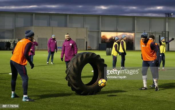 Nicolas Otamendi and Vincent Kompany in action during training at Manchester City Football Academy on November 28 2017 in Manchester England
