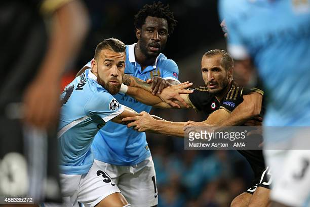 Nicolas Otamendi and Wilfried Bony of Manchester City battle with Giorgio Chiellini of Juventus at a corner during the UEFA Champions League Group D...