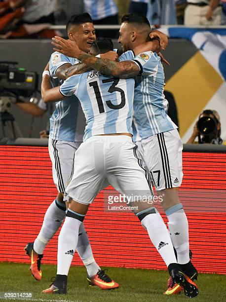 Nicolas Otamendi of Argentina celebrates teammates Ramiro Funes Mori and Marcos Rojo after scoring the first goal of his team during a group D match...