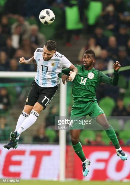 Nicolas Otamendi of Argentina heads for the ball with Kelechi Iheanacho of Nigeria during an international friendly match between Argentina and...