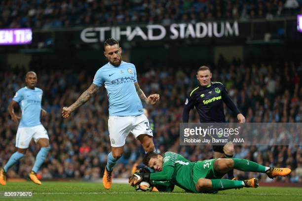 Nicolas Otamendi of Manchester City and Ederson of Manchester City during the Premier League match between Manchester City and Everton at Etihad...