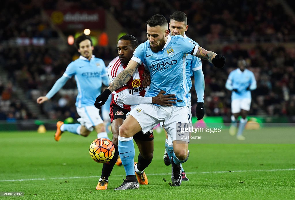 Nicolas Otamendi of Manchester City and Jermain Defoe of Sunderland compete for the ball during the Barclays Premier League match between Sunderland and Manchester City at the Stadium of Light on February 2, 2016 in Sunderland, England.