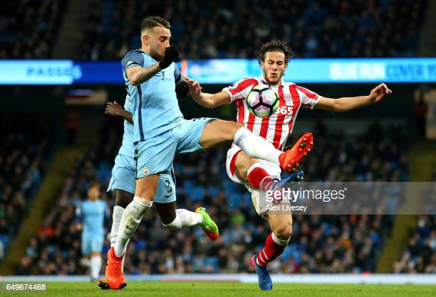 Nicolas Otamendi of Manchester City and Ramadan Sobhi of Stoke City in action during the Premier League match between Manchester City and Stoke City...