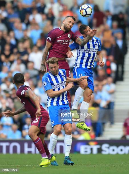 Nicolas Otamendi of Manchester City attempts to win a header over Dale Stephens of Brighton and Hove Albion during the Premier League match between...