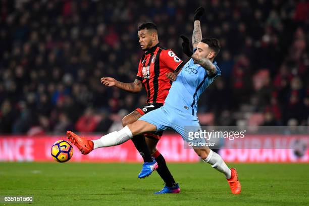 Nicolas Otamendi of Manchester City battles for the ball with Joshua King of Bournemouth during the Premier League match between AFC Bournemouth and...