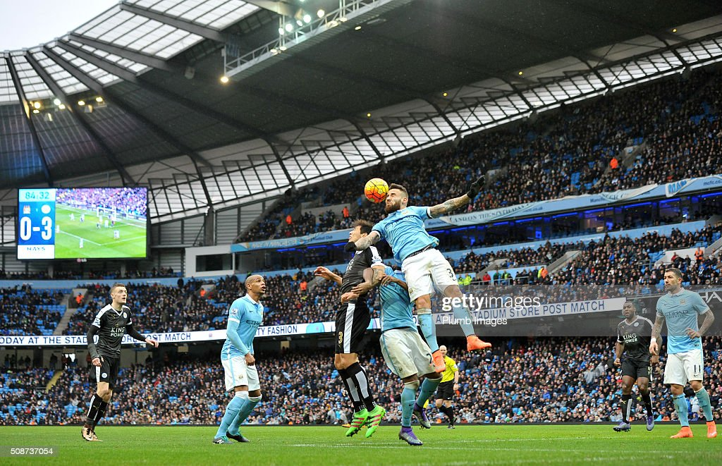 Nicolas Otamendi of Manchester City beats Shinji Okazaki of Leicester City in the air during the Premier League match between Manchester City and Leicester City at Etihad Stadium on February 6, 2016 in Manchester, United Kingdom.