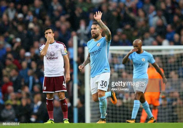 Nicolas Otamendi of Manchester City celebrates as he scores their second goal with a header during the Premier League match between Manchester City...