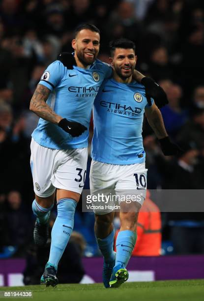 Nicolas Otamendi of Manchester City celebrates his sides third goal with Sergio Aguero of Manchester City after Virgil van Dijk of Southampton scored...