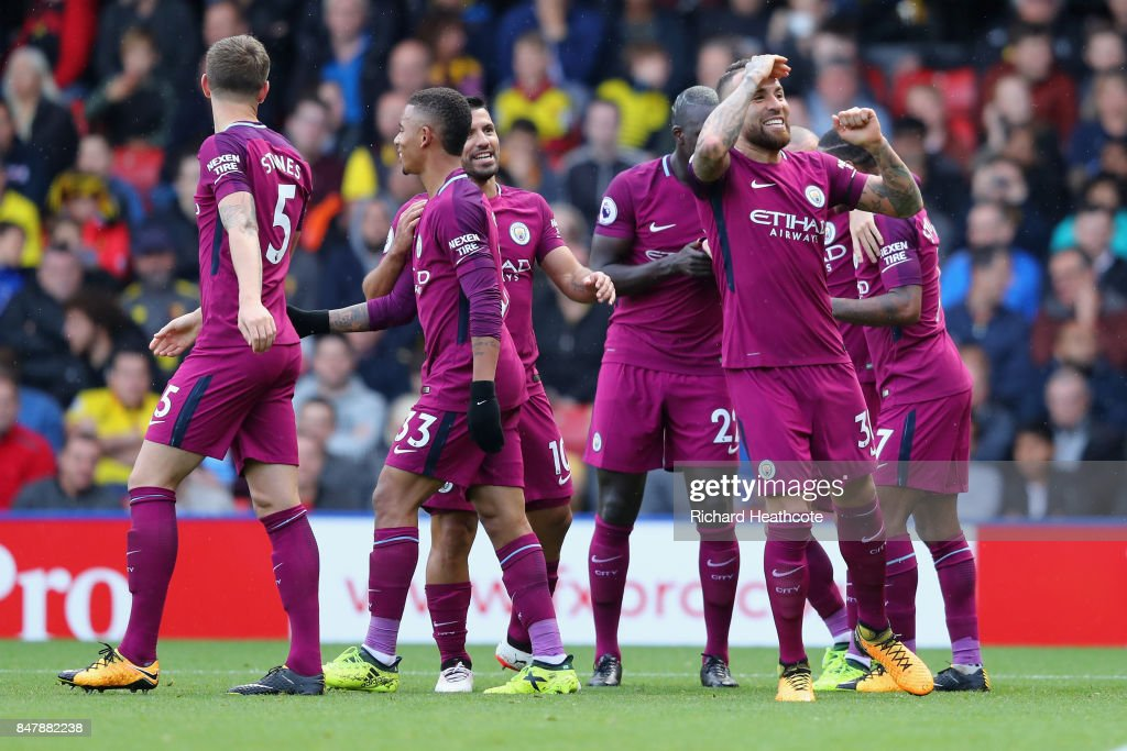 Nicolas Otamendi of Manchester City celebrates scoring his sides fourth goal with his Manchester City team mates during the Premier League match between Watford and Manchester City at Vicarage Road on September 16, 2017 in Watford, England.
